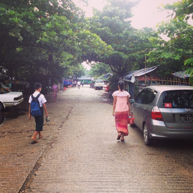 The road in front of the high school leading to the street market.
