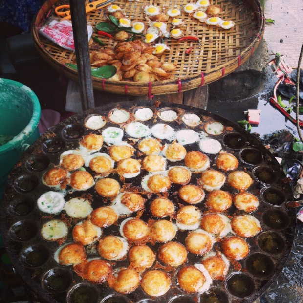 Street food. They crack a quail egg into a sizzling little hole and then fry it up. 10 for K1000 (about $1.00).