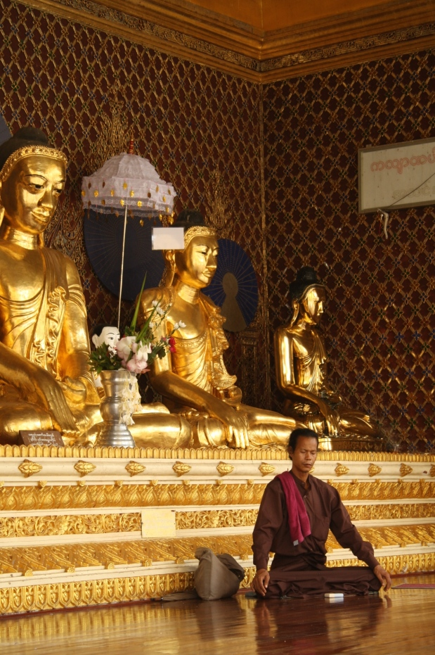 A local man meditating in one of the many rooms at Shwedagon.