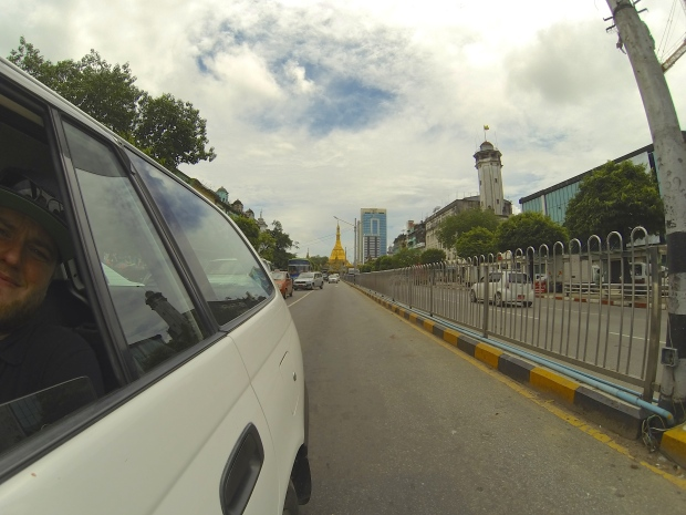 Scott trying to get a shot of Sule Pagoda as we take a taxi ride through downtown Yangon.