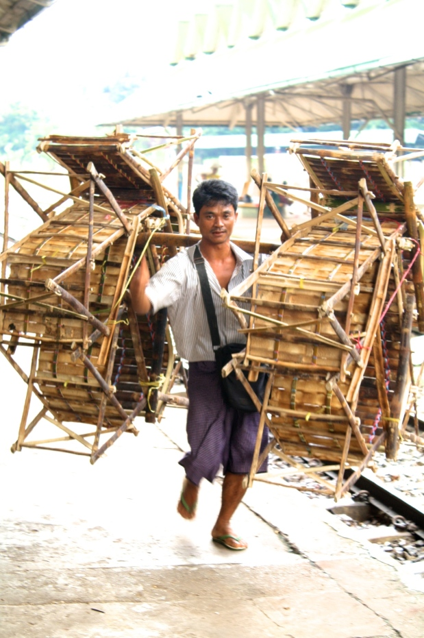 Chairs being taken off the train to be sold in the markets downtown Yangon.