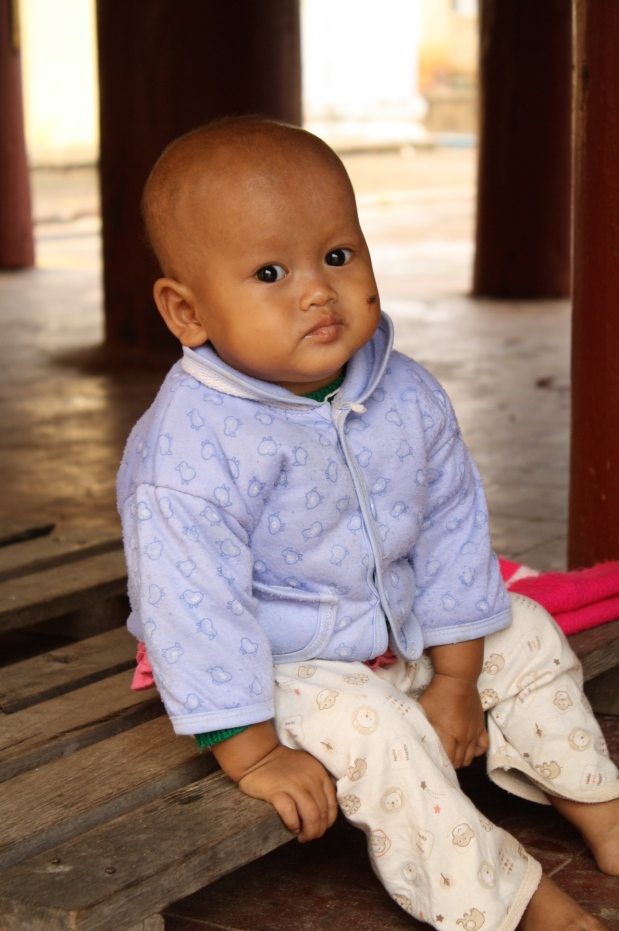 As we walked around one of the pagodas, we found this precious little one sitting by herself.