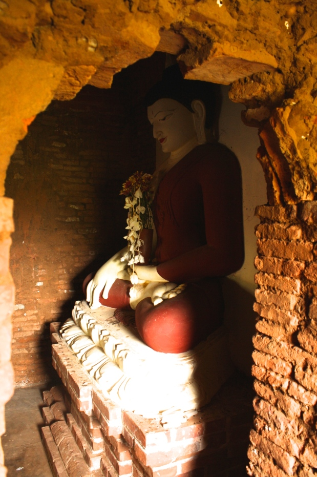Every pagoda has a stunning Buddha hiding behind red bricked walls.
