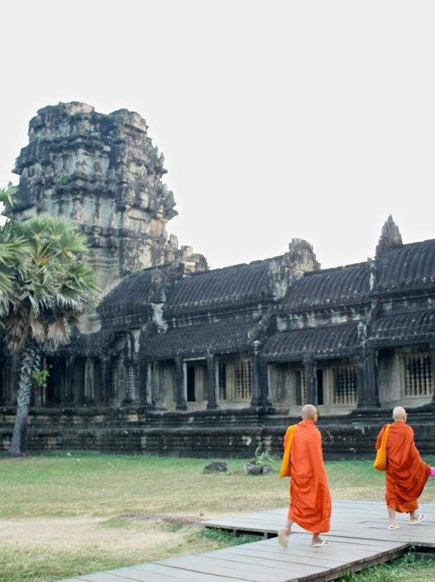 In Myanmar, Monks wear a deep red robe but here in Cambodia, they wear bright orange and yellow robes. It is a great pop of color amongst the ancient scenery.