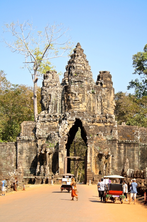 After Angkor Wat, we continued on to Angkor Thom. We pulled up on mountain bikes and were ecstatic to see  this intricate entrance.