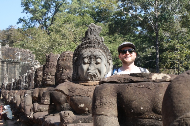 The first thing Scott wanted to do when we pulled up was to stick his head in this lineup of  ancient Cambodian statues. We were told he couldn't stand there about three times, but we finally snuck a shot by security!