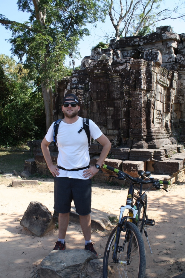 Riding bikes throughout Siem Reap and around Angkor was not my idea of a good time, but it ended up being pretty fun. We rode along the temple wall of Angkor Thom. I admitted to having fun once we were done and I did NOT fall!