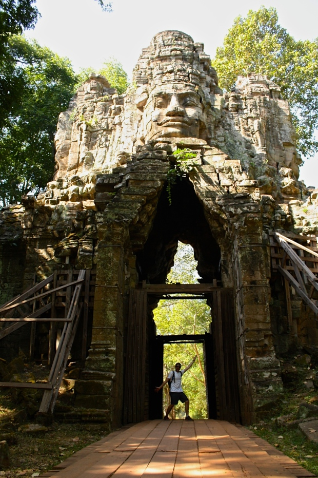 We biked along the temple walls to another entrance gate which lead us to Bayon.